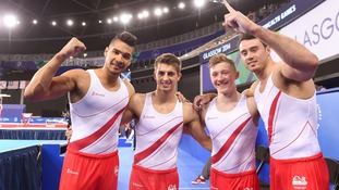 Team England win gold in gymnastics event.