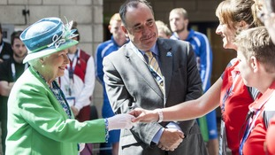 Alex Salmond joined the Queen to greet athletes on the first day of the Commonwealth Games on Thursday.