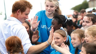 Prince Harry was greeted by children and athletes in the village.