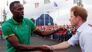 Usain Bolt met up with the royal trio on their tour of the village in Glasgow.