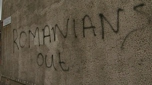 A Romanian woman had racist graffiti painted on the wall of her home in East Belfast.