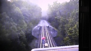 One of the women trips and falls in her panic to escape the train.