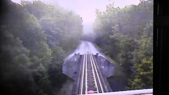 The train rides over the two women.