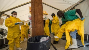 Medical staff in protective gear at an Ebola treatment centre in Sierra Leone.