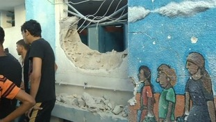 A hole is shown in the side of the school in northern Gaza.