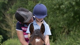 Specially trained horses help boy with autism