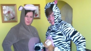 Two off-duty police officers have made an arrest while dressed in zebra and monkey onesies.