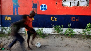 Children play football at Paynesville, DuPort Road area, in Monrovia.