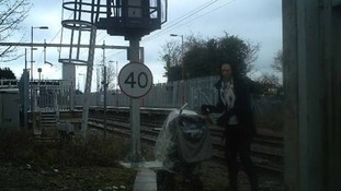 Mother seen pushing pram over rail tracks in Essex