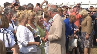 Charles and Camilla greet the crowds