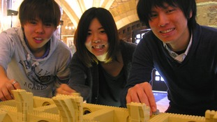 Students from Teikyo University helping with the Durham Cathedral LEGO project