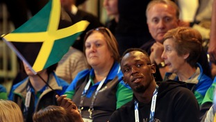 Jamaica's Usain Bolt watches the netball match between Jamaica and New Zealand in Glasgow.