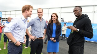 Bolt in conversation with Prince Harry and the Duke and Duchess of Cambridge earlier in the week.