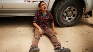 Abdul Rahman crying after 18 members of his family were killed.