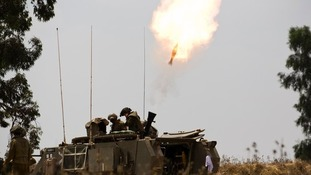 An Israeli mortar is fired.