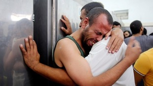 Palestinians mourn the death of their relatives.