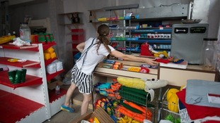 Lucy Sparrow stocks up her cornershop