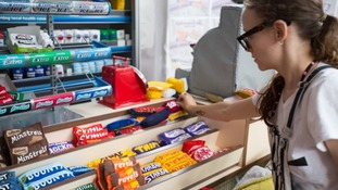 Lucy Sparrow stocks up her cornershop
