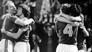 Ipswich players embrace each other after winning the UEFA Cup.