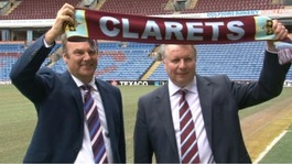 John Banaszkiewicz and Mike Garlick holding Burnley scarf