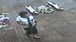 The woman who appeared to take the flowers was caught on CCTV