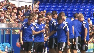 Ipswich Town players stop for a water break.