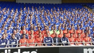 Players and fans pose for the team photo.