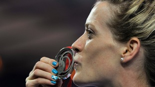 Scotland's Eilidh Child kisses her silver medal.