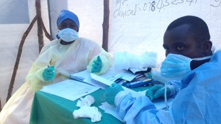 Health workers at an Ebola clinic in Sierra Leone.