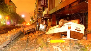 Wreckage of vehicles are seen amongst debris after an explosion in Kaohsiung, southern Taiwan