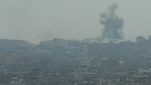 Smoke rises from the Gaza skyline.