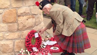 Piper lays a wreath at Hearts memorial