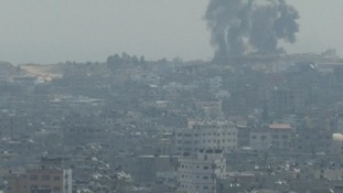 Plumes of smoke can be seen billowing over the Gaza skyline this morning.