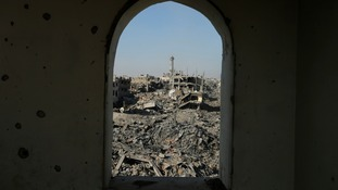 Destruction is pictured through the window of a mosque in Shejaia neighborhood, east of Gaza city.