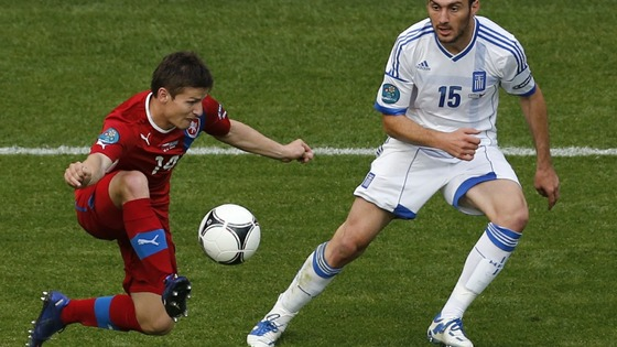 First-half goalscorer Vaclav Pilar controls the ball with Vasilis Torosidis in attendance.