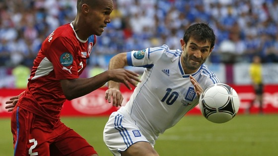 Greece&#x27;s Giorgos Karagounis, right, and Czech Republic&#x27;s Theodor Gebre Selassie.