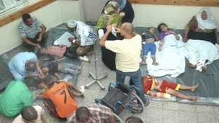 Medics attempt to treat children and adults on the floor of Rafah hospital.