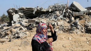 A Palestinain woman reacts upon seeing her house in the east of Khan Younis.