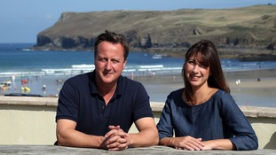 Cornwall, where the Camerons are pictured here, is also a holiday favourite.