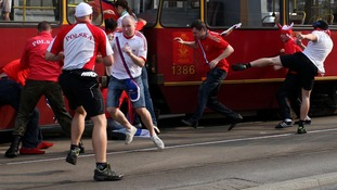Violence breaks out between opposing fans.