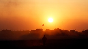 An Israeli soldier walks near the border with the Gaza Strip.