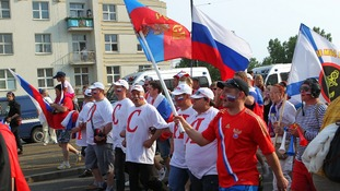 Russian fans march to celebrate their national day before the violence erupted.