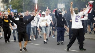 A Poland supporter makes chants towards the police.