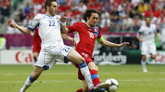Greece's Costas Fortounis, left, and Czech Republic's Tomas Rosicky fight for the ball.
