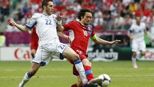 Greece&#x27;s Costas Fortounis, left, and Czech Republic&#x27;s Tomas Rosicky fight for the ball.
