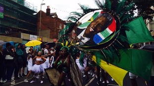 Nelson Mandela's image features heavily in the parade
