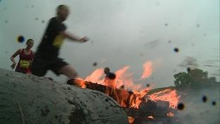 Man runs over fire