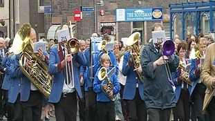 A marching band paraded through the streets.