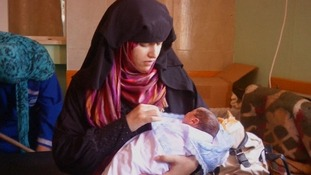 The babies' mother Reham with one of her 'miracle' quadruplets.