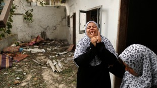 A Palestinian woman cries outside a house witnesses said was hit by an Israeli air strike in Jabaliya refugee camp in Gaza.